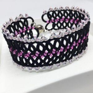 Armband Infinity schwarz pink